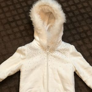 Cream fuzzy zip up sweatshirt.